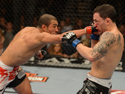 LAS VEGAS, NV - FEBRUARY 02:  (L-R) Jose Aldo punches Frankie Edgar during their featherweight title fight at UFC 156 on February 2, 2013 at the Mandalay Bay Events Center in Las Vegas, Nevada.  (Photo by Donald Miralle/Zuffa LLC/Zuffa LLC via Getty Image