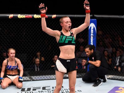 LAS VEGAS, NEVADA - DECEMBER 10:  (R-L) Rose Namajunas celebrates her submission victory over Paige VanZant in their women's strawweight bout during the UFC Fight Night event at The Chelsea at the Cosmopolitan of Las Vegas on December 10, 2015 in Las Vega