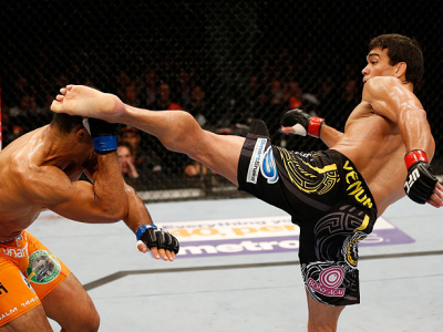 MANCHESTER, ENGLAND - OCTOBER 26:  (R-L) Lyoto Machida knocks out Mark Munoz with a kick in their middleweight bout during the UFC Fight Night event at Phones 4 U Arena on October 26, 2013 in Manchester, England. (Photo by Josh Hedges/Zuffa LLC/Zuffa LLC