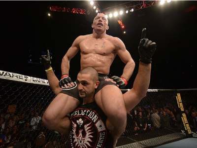 LAS VEGAS, NV - NOVEMBER 16:  Georges St-Pierre (top) reacts to his victory over Johny Hendricks in their UFC welterweight championship bout during the UFC 167 event inside the MGM Grand Garden Arena on November 16, 2013 in Las Vegas, Nevada. (Photo by Do