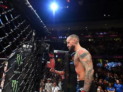 CLEVELAND, OH - SEPTEMBER 10:  Phil 'CM Punk' Brooks prepares to enter the Octagon prior to facing Mickey Gall in their welterweight bout during the UFC 203 event at Quicken Loans Arena on September 10, 2016 in Cleveland, Ohio. (Photo by Josh Hedges/Zuffa