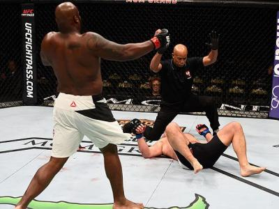 LAS VEGAS, NV - FEBRUARY 06:  Derrick Lewis (L) celebrates after his knockout victory over Damian Grabowski of Poland in their heavyweight bout during the UFC Fight Night event at MGM Grand Garden Arena on February 6, 2016 in Las Vegas, Nevada.  (Photo by