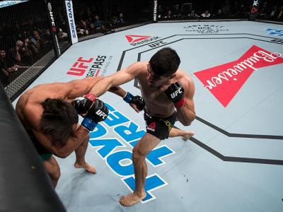 BRASILIA, BRAZIL - SEPTEMBER 24: Vicente Luque of Brazil punches Hector Urbina of Mexico in their weight-welterweight UFC bout during the UFC Fight Night event at Nilson Nelson gymnasium on September 24, 2016 in Brasilia, Brazil. (Photo by Buda Mendes/Zuf