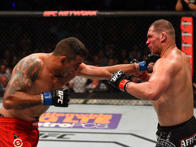 MEXICO CITY, MEXICO - JUNE 13:   (L-R) Fabricio Werdum of Brazil punches Cain Velasquez of the United States in their UFC heavyweight championship bout during the UFC 188 event inside the Arena Ciudad de Mexico on June 13, 2015 in Mexico City, Mexico. (Ph