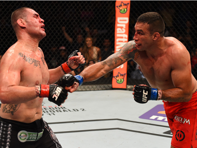 MEXICO CITY, MEXICO - JUNE 13:   (R-L) Fabricio Werdum of Brazil punches Cain Velasquez of the United States in their UFC heavyweight championship bout during the UFC 188 event inside the Arena Ciudad de Mexico on June 13, 2015 in Mexico City, Mexico. (Ph