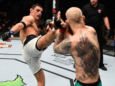 VANCOUVER, BC - AUGUST 27:   (L-R) Alessio Di Chirico of Italy kicks Garreth McLellan of South Africa in their middleweight bout during the UFC Fight Night event at Rogers Arena on August 27, 2016 in Vancouver, British Columbia, Canada. (Photo by Jeff Bot