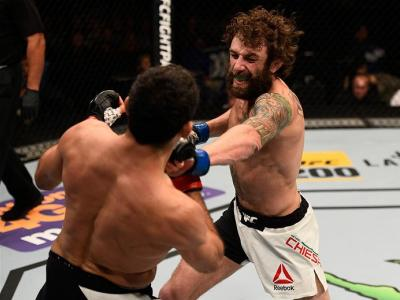 TAMPA, FL - APRIL 16:   (R-L) Michael Chiesa punches Beneil Dariush in their lightweight bout during the UFC Fight Night event at Amalie Arena on April 16, 2016 in Tampa, Florida. (Photo by Jeff Bottari/Zuffa LLC/Zuffa LLC via Getty Images)