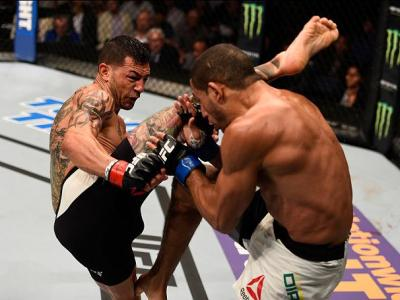 TAMPA, FL - APRIL 16:   (L-R) Cub Swanson kicks Hacran Dias in their featherweight bout during the UFC Fight Night event at Amalie Arena on April 16, 2016 in Tampa, Florida. (Photo by Jeff Bottari/Zuffa LLC/Zuffa LLC via Getty Images)