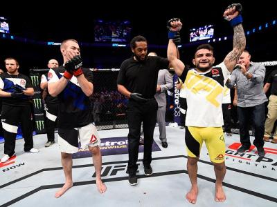SIOUX FALLS, SD - JULY 13:   (R-L) John Lineker celebrates his knockout victory over Michael McDonald in their bantamweight bout during the UFC Fight Night event on July 13, 2016 at Denny Sanford Premier Center in Sioux Falls, South Dakota. (Photo by Jeff