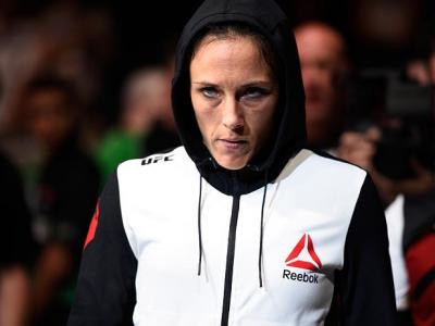 OTTAWA, ON - JUNE 18:   Valerie Letourneau of Canada prepares to enter the Octagon before facing Joanne Calderwood of Scotland in their women's flyweight bout during the UFC Fight Night event inside the TD Place Arena on June 18, 2016 in Ottawa, Ontario,
