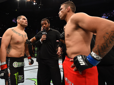 MEXICO CITY, MEXICO - JUNE 13:   (R-L) Fabricio Werdum of Brazil and Cain Velasquez of the United States face off in their UFC heavyweight championship bout during the UFC 188 event inside the Arena Ciudad de Mexico on June 13, 2015 in Mexico City, Mexico