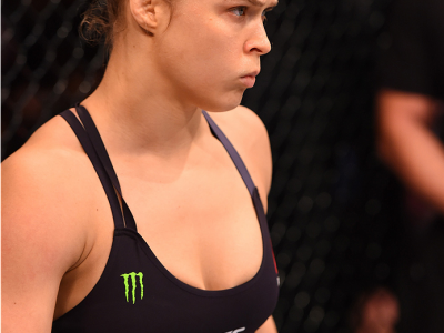 RIO DE JANEIRO, BRAZIL - AUGUST 01:  UFC strawweight champion Ronda Rousey of the United States enters the Octagon before facing Bethe Correia of Brazil in their UFC women's bantamweight championship bout during the UFC 190 event inside HSBC Arena on Augu