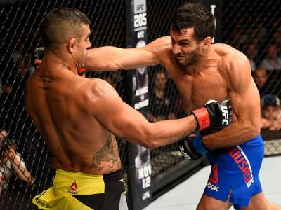 MANCHESTER, ENGLAND - OCTOBER 08:  (R-L) Gegard Mousasi of The Netherlands punches Vitor Belfort of Brazil in their middleweight bout during the UFC 204 Fight Night at the Manchester Evening News Arena on October 8, 2016 in Manchester, England. (Photo by