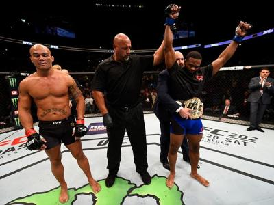 ATLANTA, GA - JULY 30:  (R-L)Tyron Woodley celebrates his knockout victory over Robbie Lawler in their welterweight championship bout during the UFC 201 event on July 30, 2016 at Philips Arena in Atlanta, Georgia. (Photo by Jeff Bottari/Zuffa LLC/Zuffa LL