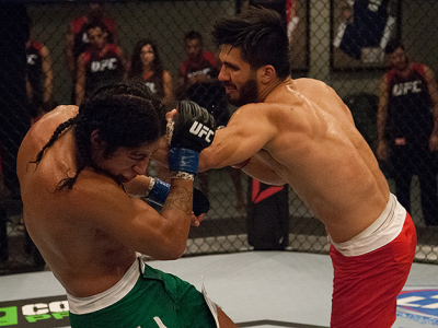 LAS VEGAS, NV - MARCH 27:  (R-L) Horacio Gutierrez punches Danny Salas during the filming of The Ultimate Fighter Latin America: Team Gastelum vs Team Escudero  on March 27, 2015 in Las Vegas, Nevada. (Photo by Brandon Magnus/Zuffa LLC/Zuffa LLC via Getty