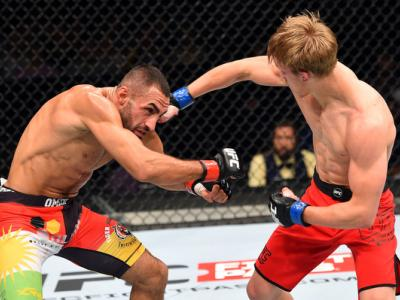 BERLIN, GERMANY - JUNE 20:  (R-L) Arnold Allen of England punches Alan Omer of Iraq in their featherweight bout during the UFC Fight Night event at the O2 World on June 20, 2015 in Berlin, Germany. (Photo by Josh Hedges/Zuffa LLC/Zuffa LLC via Getty Image