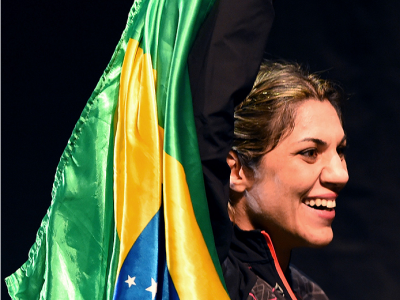 RIO DE JANEIRO, BRAZIL - JULY 31:  Bethe Correia prepares to step onto the scale during the UFC 190 weigh-in inside HSBC Arena on July 31, 2015 in Rio de Janeiro, Brazil.  (Photo by Josh Hedges/Zuffa LLC/Zuffa LLC via Getty Images)