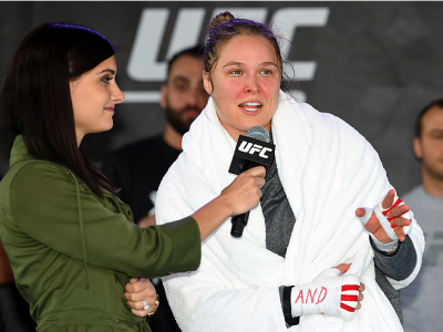 MELBOURNE, AUSTRALIA - NOVEMBER 12:  UFC women's bantamweight champion Ronda Rousey (R) of the United States is interviewed by Megan Olivi after an open workout for fans and media at Federation Square on November 12, 2015 in Melbourne, Australia. (Photo b