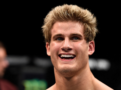 LAS VEGAS, NEVADA - DECEMBER 10:  Sage Northcutt celebrates his win over Cody Pfister in their lightweight bout during the UFC Fight Night event at The Chelsea at the Cosmopolitan of Las Vegas on December 10, 2015 in Las Vegas, Nevada.  (Photo by Jeff Bot