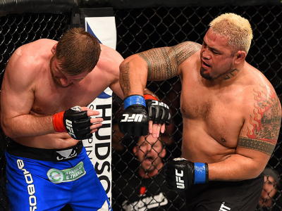 ADELAIDE, AUSTRALIA - MAY 10:   (R-L) Mark Hunt punches Stipe Miocic in their heavyweight bout during the UFC Fight Night event at the Adelaide Entertainment Centre on May 10, 2015 in Adelaide, Australia. (Photo by Josh Hedges/Zuffa LLC/Zuffa LLC via Gett