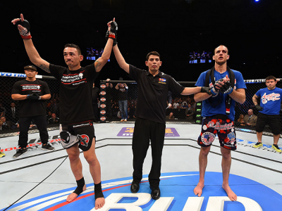 BROOMFIELD, CO - FEBRUARY 14:  (L-R) Max Holloway celebrates after defeating Cole Miller in their featherweight fight during the UFC Fight Night event inside 1stBank Center on February 14, 2015 in Broomfield, Colorado. (Photo by Josh Hedges/Zuffa LLC/Zuff
