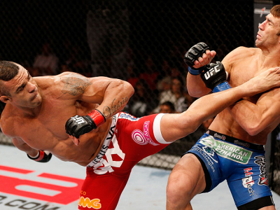 JARAGUA DO SUL, BRAZIL - MAY 18: (L-R) Vitor Belfort knocks out Luke Rockhold with a spinning heel kick in their middleweight bout during the UFC on FX event on May 18, 2013 at Arena Jaragua in Jaragua do Sul, Santa Catarina, Brazil. (Photo by Josh Hedges