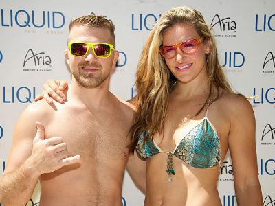 LAS VEGAS, NV - JULY 3:  Mixed martial artists Brian Caraway (L) and Miesha Tate arrive at the UFC pool party during UFC International Fight Week at the Liquid Pool Lounge at the Aria Resort & Casino at CityCenter on July 3, 2014 in Las Vegas, Nevada. (Ph