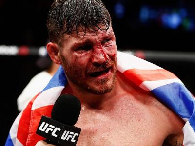 LONDON, ENGLAND - FEBRUARY 27:  A bloody and battered Michael 'The Count' Bisping of England celebrates victory over Anderson 'The Spider' Silva of Brazil in their Middleweight bout during the UFC Fight Night held at at Indigo at The O2 Arena on February