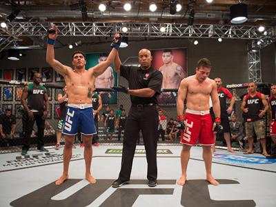 LAS VEGAS, NV - APRIL 21:  (L-R) Erick Monta–o celebrates his submission victory over Vernon Ramos in their semi-finals fight during the filming of The Ultimate Fighter Latin America: Team Gastelum vs Team Escudero on April 21, 2015 in Las Vegas, Nevada.