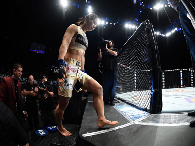 LAS VEGAS, NEVADA - DECEMBER 12: Seohee Ham enters the Octagon before facing Joanne Calderwood in their strawweight fight during The Ultimate Fighter Finale event inside the Palms Casino Resort on December 12, 2014 in Las Vegas, Nevada. (Photo by Jeff Bot