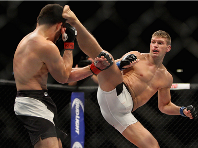LAS VEGAS, NV - JULY 12:  (R-L) Stephen Thompson kicks Jake Ellenberger in their welterweight bout during the Ultimate Fighter Finale inside MGM Grand Garden Arena on July 12, 2015 in Las Vegas, Nevada.  (Photo by Mitch Viquez/Zuffa LLC/Zuffa LLC via Gett