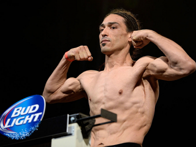 DALLAS, TX - MARCH 14:  Francisco Trevino steps on the scale during the UFC 171 weigh-in event at Gilley's Dallas on March 14, 2014 in Dallas, Texas. (Photo by Jeff Bottari/Zuffa LLC/Zuffa LLC via Getty Images)