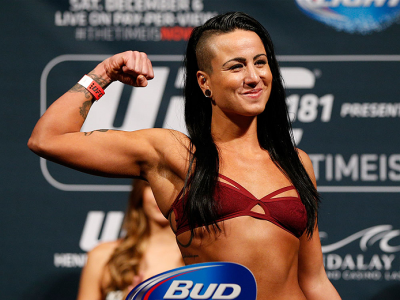 LAS VEGAS, NV - DECEMBER 05:  Ashlee Evans-Smith poses on the scale after weighing in during the UFC 181 weigh-in inside the Mandalay Bay Events Center on December 5, 2014 in Las Vegas, Nevada.  (Photo by Josh Hedges/Zuffa LLC/Zuffa LLC via Getty Images)