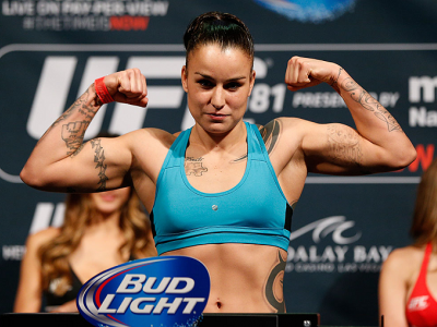 LAS VEGAS, NV - DECEMBER 05:  Raquel Pennington poses on the scale after weighing in during the UFC 181 weigh-in inside the Mandalay Bay Events Center on December 5, 2014 in Las Vegas, Nevada.  (Photo by Josh Hedges/Zuffa LLC/Zuffa LLC via Getty Images)