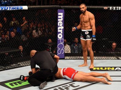 LOS ANGELES, CA - FEBRUARY 28:  (R) Roan Carneiro celebrates his win over Mark Munoz by submission in their middleweight bout during the UFC 184 event at Staples Center on February 28, 2015 in Los Angeles, California.  (Photo by Josh Hedges/Zuffa LLC/Zuff