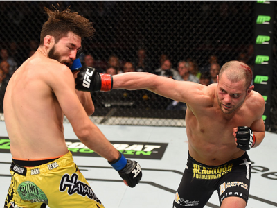MONTREAL, QC - APRIL 25:   (R-L) Chad Laprise of Canada punches Bryan Barberena of the United States in their lightweight bout during the UFC 186 event at the Bell Centre on April 25, 2015 in Montreal, Quebec, Canada. (Photo by Josh Hedges/Zuffa LLC/Zuffa