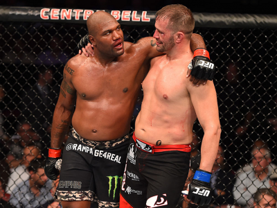 MONTREAL, QC - APRIL 25:   (L-R) Quinton 'Rampage' Jackson of the United States and Fabio Maldonado of Brazil hug after their catchweight bout during the UFC 186 event at the Bell Centre on April 25, 2015 in Montreal, Quebec, Canada. (Photo by Josh Hedges
