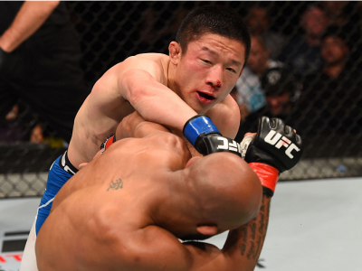 MONTREAL, QC - APRIL 25:   (L-R) Kyoji Horiguchi of Japan punches Demetrious Johnson of the United States in their UFC flyweight championship bout during the UFC 186 event at the Bell Centre on April 25, 2015 in Montreal, Quebec, Canada. (Photo by Josh He