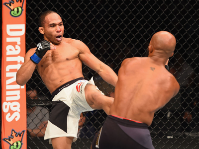 LAS VEGAS, NV - SEPTEMBER 05: (L-R) John Dodson kicks Demetrious Johnson in their flyweight championship bout during the UFC 191 event inside MGM Grand Garden Arena on September 5, 2015 in Las Vegas, Nevada.  (Photo by Josh Hedges/Zuffa LLC/Zuffa LLC via
