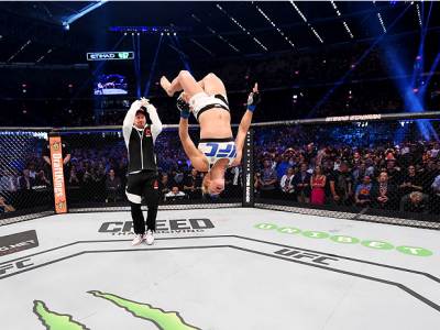 MELBOURNE, AUSTRALIA - NOVEMBER 15:  Holly Holm does a back-flip in celebrateion of her second round KO (head kick and punches) over Ronda Rousey (not pictured) to win their UFC women's bantamweight championship bout during the UFC 193 event at Etihad Sta