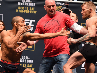 LAS VEGAS, NV - DECEMBER 11:  (L-R) UFC featherweight champion Jose Aldo of Brazil and interim UFC featherweight champion Conor McGregor of Ireland face off during the UFC 194 weigh-in inside MGM Grand Garden Arena on December 10, 2015 in Las Vegas, Nevad