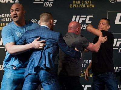 LAS VEGAS, NV - MARCH 3:   (L-R) UFC featherweight champion Conor McGregor and Nate Diaz are separated during the UFC 196 Press Conference at David Copperfield Theater in the MGM Grand Hotel/Casino on March 3, 2016 in Las Vegas, Nevada. (Photo by Brandon