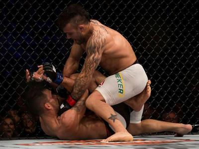 CURITIBA, BRAZIL - MAY 14: Jonh Lineker of Brazil punches Rob Font of the United States in their bantamweight bout during the UFC 198 at Arena da Baixada stadium on May 14, 2016 in Curitiba, Brazil. (Photo by Buda Mendes/Zuffa LLC/Zuffa LLC via Getty Imag
