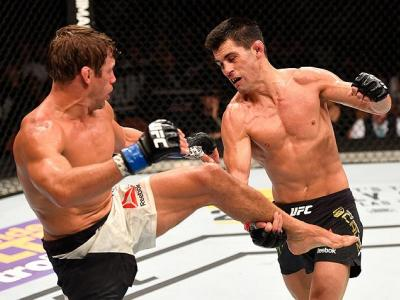 INGLEWOOD, CA - JUNE 04:  Urijah Faber kicks Dominick Cruz in their UFC bantamweight championship bout during the UFC 199 event at The Forum on June 4, 2016 in Inglewood, California.  (Photo by Josh Hedges/Zuffa LLC/Zuffa LLC via Getty Images)