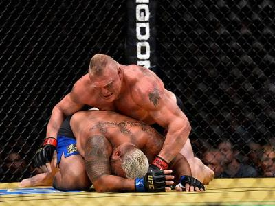 LAS VEGAS, NV - JULY 09: Brock Lesnar (top) punches Mark Hunt of New Zealand during the UFC 200 event on July 9, 2016 at T-Mobile Arena in Las Vegas, Nevada.  (Photo by Brandon Magnus/Zuffa LLC/Zuffa LLC via Getty Images) *** Local Caption *** Brock Lesna