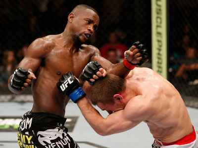 ALBUQUERQUE, NM - JUNE 07:  (L-R) Yves Edwards punches Piotr Hallmann in their lightweight fight during the UFC Fight Night event at Tingley Coliseum on June 7, 2014 in Albuquerque, New Mexico.  (Photo by Josh Hedges/Zuffa LLC/Zuffa LLC via Getty Images)