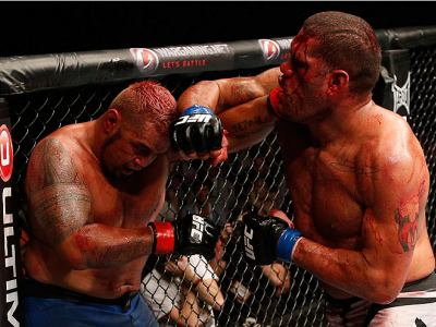 "BRISBANE, AUSTRALIA - DECEMBER 07:  (R-L) Antonio ""Bigfoot"" Silva punches Mark Hunt in their heavyweight fight during the UFC Fight Night event at the Brisbane Entertainment Centre on December 7, 2013 in Brisbane, Australia. (Photo by Josh Hedges/Zuffa LL"