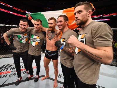BOSTON, MA - JANUARY 18:  Conor McGregor of Ireland celebrates with members of his team after defeating Dennis Siver of Germany in their featherweight fight during the UFC Fight Night event at the TD Garden on January 18, 2015 in Boston, Massachusetts. (P