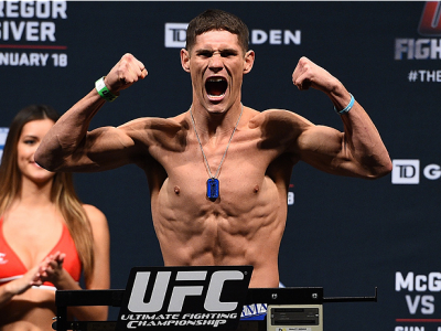 BOSTON, MA - JANUARY 17:  Charles Rosa steps on the scale during the UFC Fight Night Boston weigh-in event at the Orpheum Theatre on January 17, 2015 in Boston, Massachusetts. (Photo by Jeff Bottari/Zuffa LLC/Zuffa LLC via Getty Images)