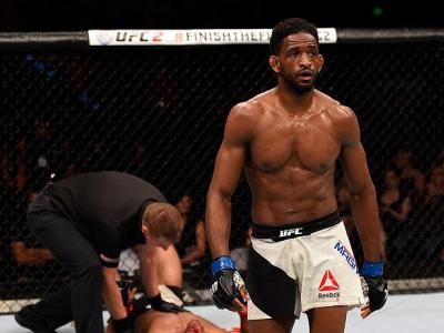 BRISBANE, AUSTRALIA - MARCH 20:  (R-L) Neil Magny of the United States walks to his corner after defeating Hector Lombard of Cuba in their welterweight bout during the UFC Fight Night event at the Brisbane Entertainment Centre on March 20, 2016 in Brisban